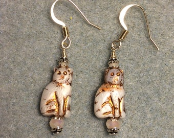 Small white Czech glass cat bead earrings adorned with white Chinese crystal beads.