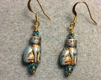Small light turquoise Czech glass cat bead dangle earrings adorned with turquoise Chinese crystal beads.