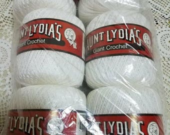 6 balls of Aunt Lydia's crochet thread in white. Mercerized cotton 100 %, 400 yards 365 meters in length.  Machine washable made in the USA.