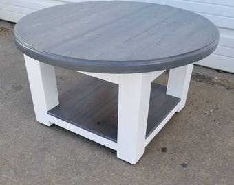 Round Farmhouse Coffee Table With Gray Stained Top And Lower Shelf