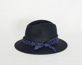 Grey fedora hat decorated with a cotton scarf