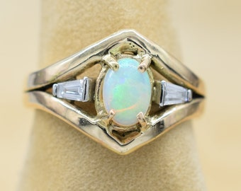 Australian crystal opal ring with baguette diamonds set in 14k gold