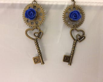 Small blue rose earrings on antique gold steampunk gears with a double heart key, hook earring wires, nickel free, steampunk, cosplay, goth