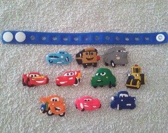 Lot 10 jibbitz Cars + (badges for fangs) bracelet
