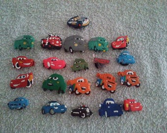 Lot 21 jibbitz Cars (badges for fangs)