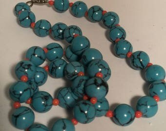 Turquoise Stone with Orange Accents