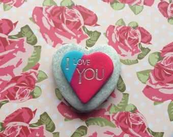"Pink & blue clay heart inscribed ""I Love You"" mounted on Heart Shaped Stone"