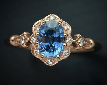 Oval Natural Corn Blue Sapphire Engagement ring  7x5 in 14kt Pink Gold with flower halo and and accent diamonds