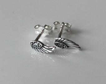 Sterling silver angel wing earrings. Silver angel wing earrings. Silver earrings. Angel wing stud earrings