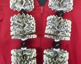 Money lei with 50 dollar bills for graduation weddings or birthdays made with 50 one dollar bills