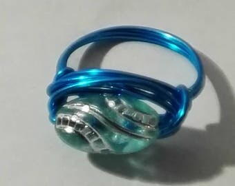 light blue ring with blue oval ornament