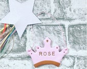 Personalised clay crown decoration.