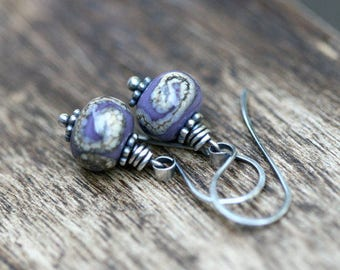Artisan Lamp work in Lilac earrings . solitary minimalist purple lampwork . small delicate dance boho . bohemian jewelry . sterling silver