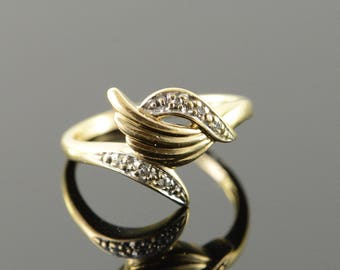 10k Genuine Diamond Bypass Scroll Ring Gold