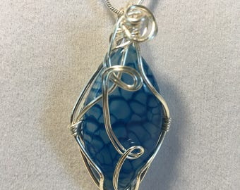 blue dragon's vein cabochon wrapped in silver wire