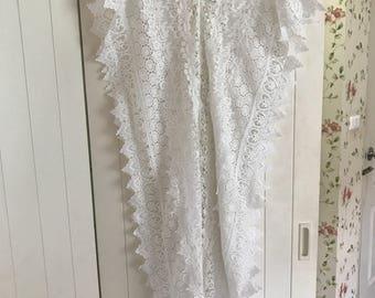 White lace kaftan with polkadot shoulder detail.