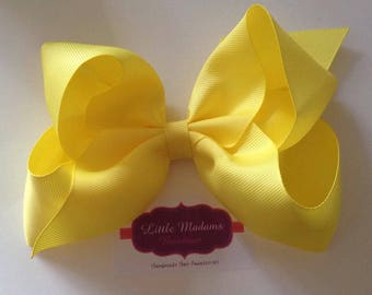 6 inch yellow boutique bow.