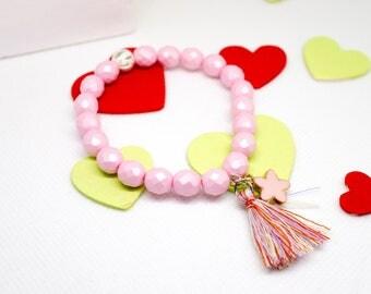Bracelet pastel pink Czech faceted beads, silvered metal stardust ball, rose gold enamel flower