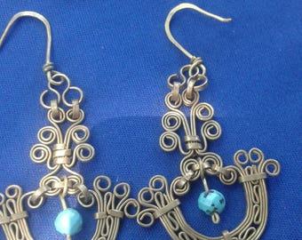 Bras earrings