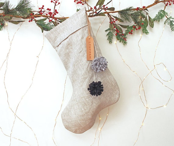 Personalised Linen Christmas Stocking with leather name tag and pom poms