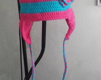 bonnet girl with a pretty pink and turquoise flower