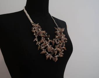 Crocheted shining necklace with seashells, pearls and crystals