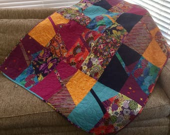 Bright and cheery lap quilt with mixture of multicolor Kaffe and other fabrics.