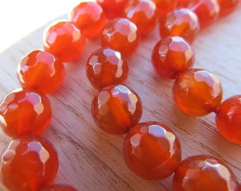 Set of 10 faceted round 8 mm carnelian beads.
