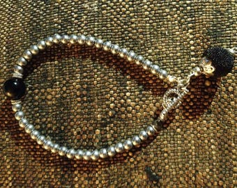 Indian bead embellished black glass pearl bracelet with silver glass beads