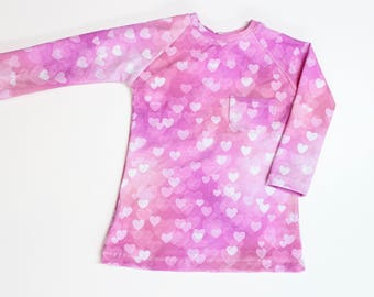 Toddler Girl Raglan Sleeve Tunic Length Shirt. Pink Bokeh Hearts with Pocket