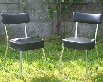 Two black leatherette office chairs