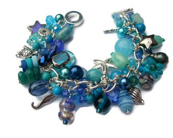 Ocean blue charm bracelet, blue and silver sea shell charm bracelet, beach jewellery, holiday jewellery, seahorse and turtle charm bracelet.