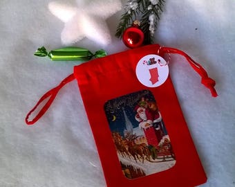 Mini bag fabric red Santa Claus on roofs.