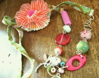 Necklace materials tender colors.