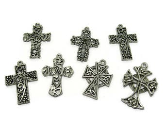 7 large worked silver cross charms / fancy