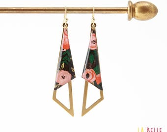 Earrings are made of resinees black floral pattern