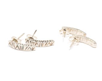 Tribal arched studs
