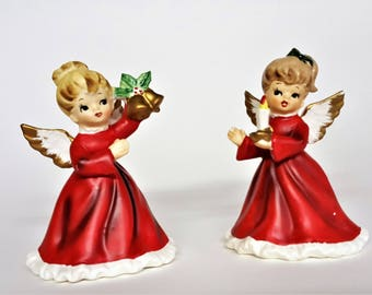 Napco Christmas Angels Pair Angel with Bell Angel with Candle Red Gown No Chips or Cracks Small Dots of Paint Loss