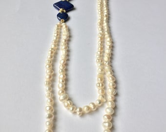 Long Pearl River necklace with lapis decorations