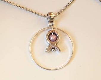 girls silver ring and fish pendant necklace