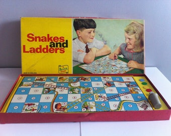 1960's Snakes and ladders, Berwick games, board, dice, shaker and counters, complete.