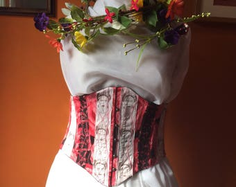 White and pink underbust corset with busk and lacing, featuring Frida Kahlo fabric.