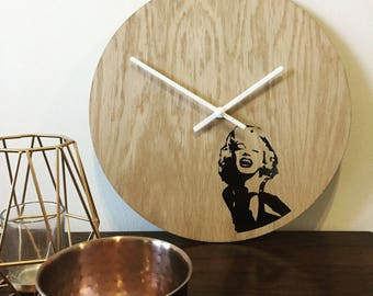 Quirky Marilyn wall art clock stunning black design against natural oak face