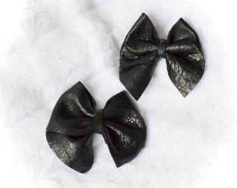 Black Leather Cross Bow