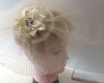 ivory. pleated crinoline fascinator on a sinnamay base on a satin bound headband