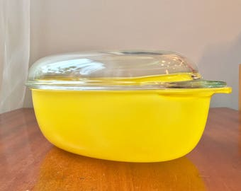 Vintage 1970s yellow casserole perfect for a retro kitchen