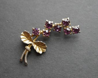 Purple flower sprig gold tone vintage brooch with purple rhinestones