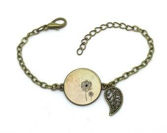 """Bracelet jaune"""" Pissenlit  """", fleur ,image sous cabochon résine ,monture couleur bronze,ref bN 37"""