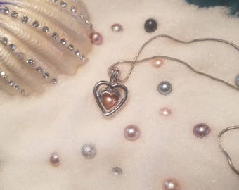Heart pendant with cultured pearl inside. Simple
