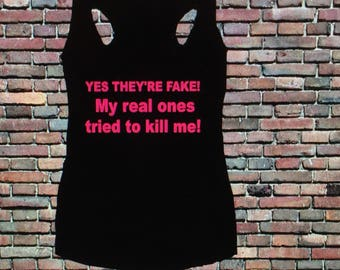 Yes they're fake my real ones tried to kill me racerback tank. Cancer tank. Cancer shirt.